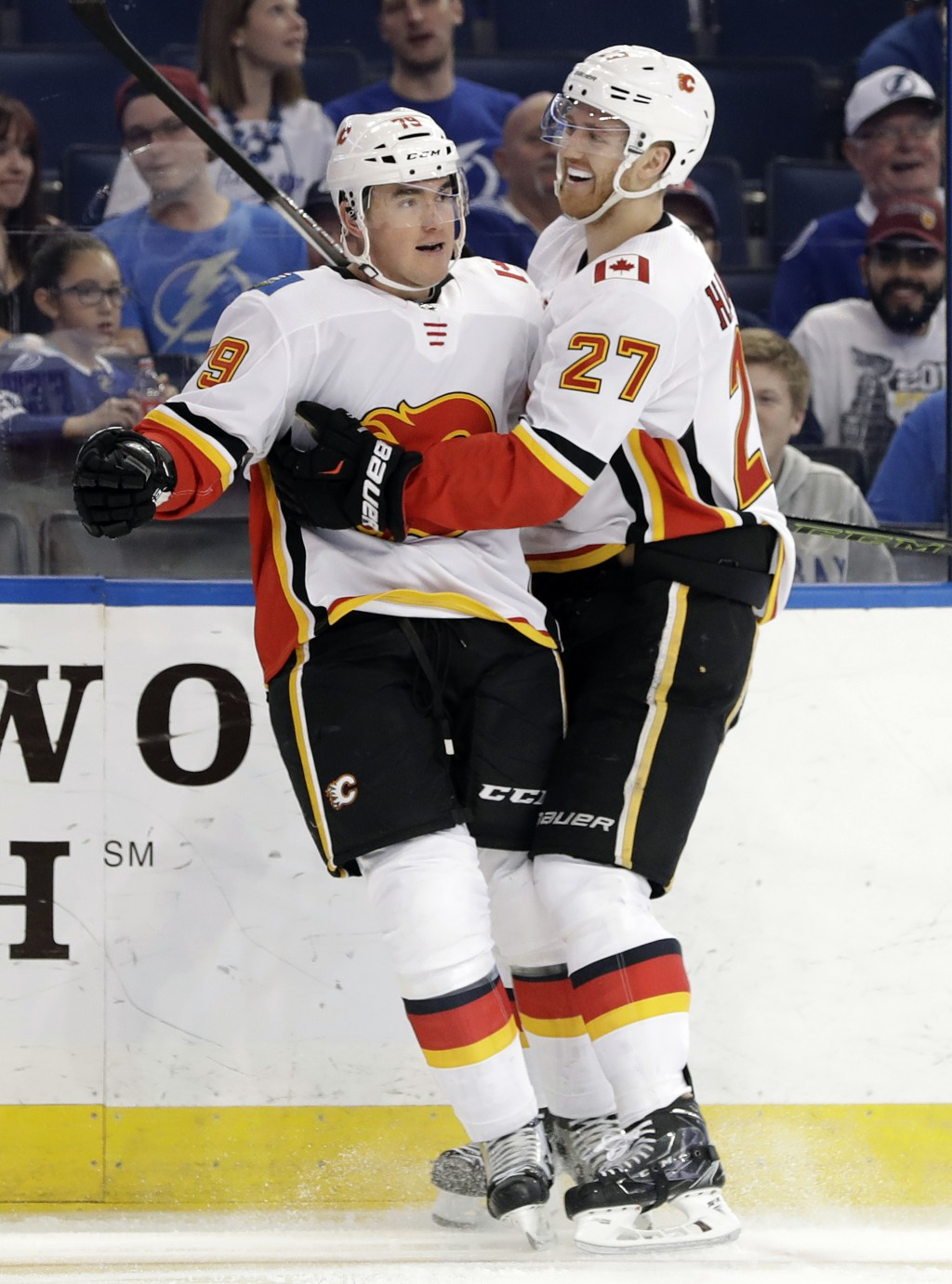 Calgary Flames left wing Micheal Ferland (79) celebrates his goal against the Tampa Bay Lightning with defenseman Dougie Hamilton (27) during the firs