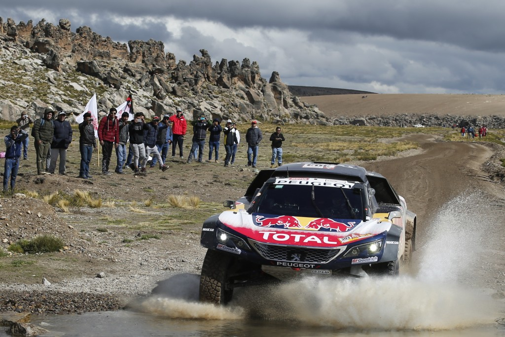 Driver Carlos Sainz, of Spain, and co-driver Lucas Cruz, of Spain, race their Peugeot during the 6th stage of the 2018 Dakar Rally between Arequipa, P