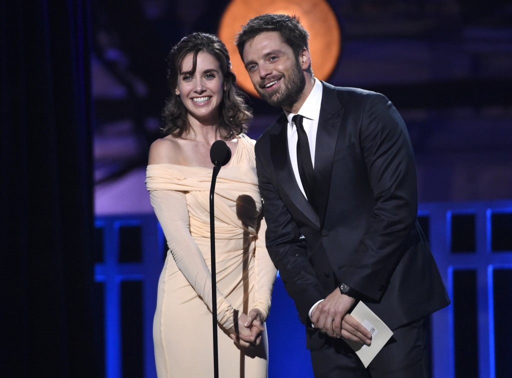 Alison Brie, left, and Sebastian Stan present the award for best action movie at the 23rd annual Critics' Choice Awards at the Barker Hangar on Thursd