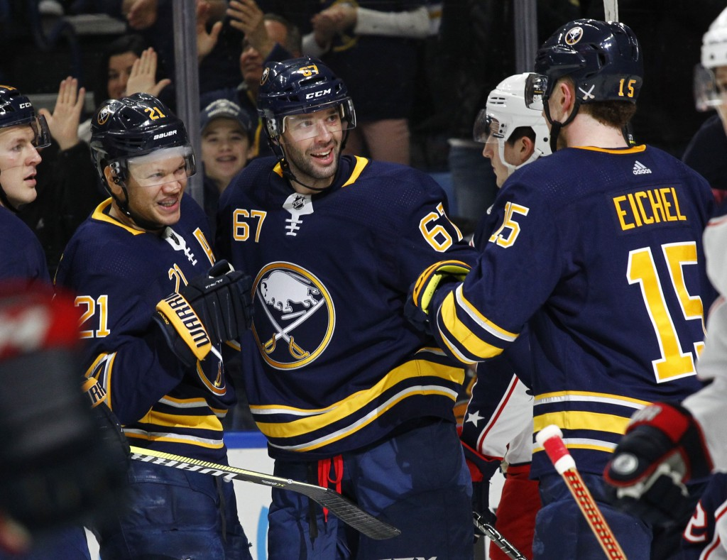 Buffalo Sabres' Kyle Okposo (21) and Benoit Pouliot (67) celebrate a goal during the first period of an NHL hockey game against the Columbus Blue Jack