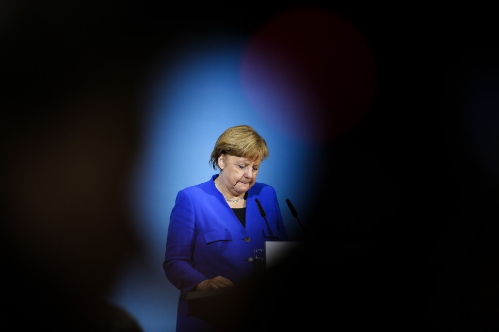 German Chancellor Angela Merkel attends a joint statement after the exploratory talks between Merkel's conservative bloc and the Social Democrats on f