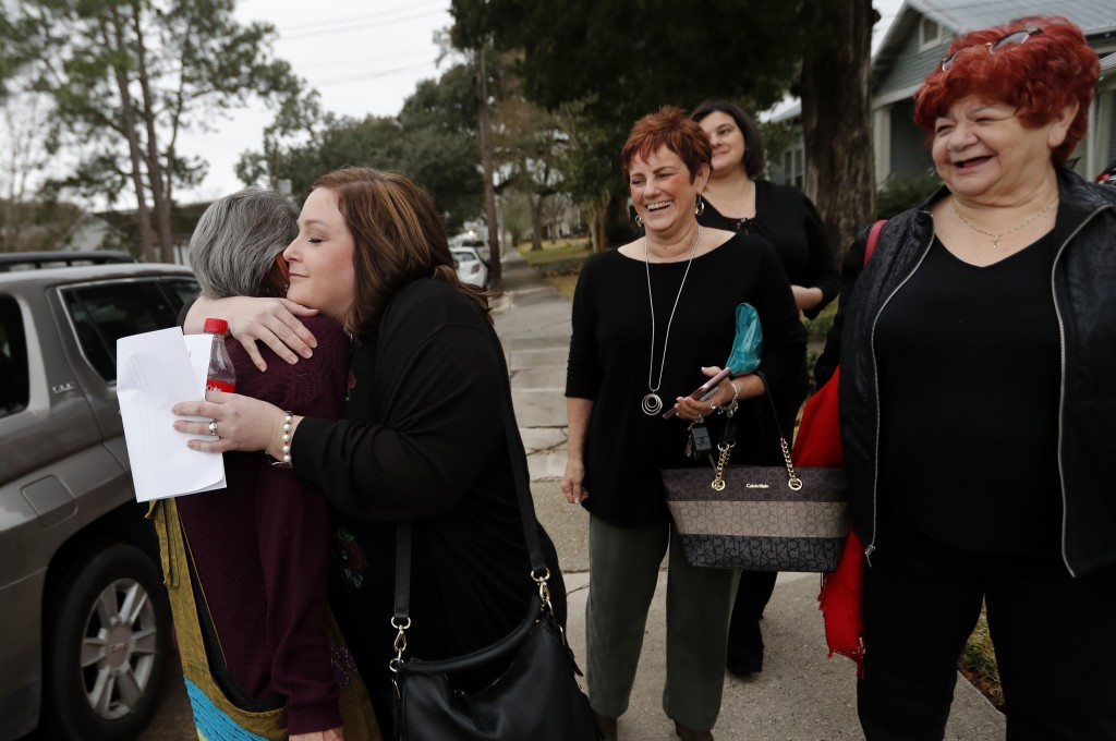 Deyshia Hargrave, facing left, the Vermilion Parish school teacher who was arrested while speaking against the superintendent's pay raise at an educat
