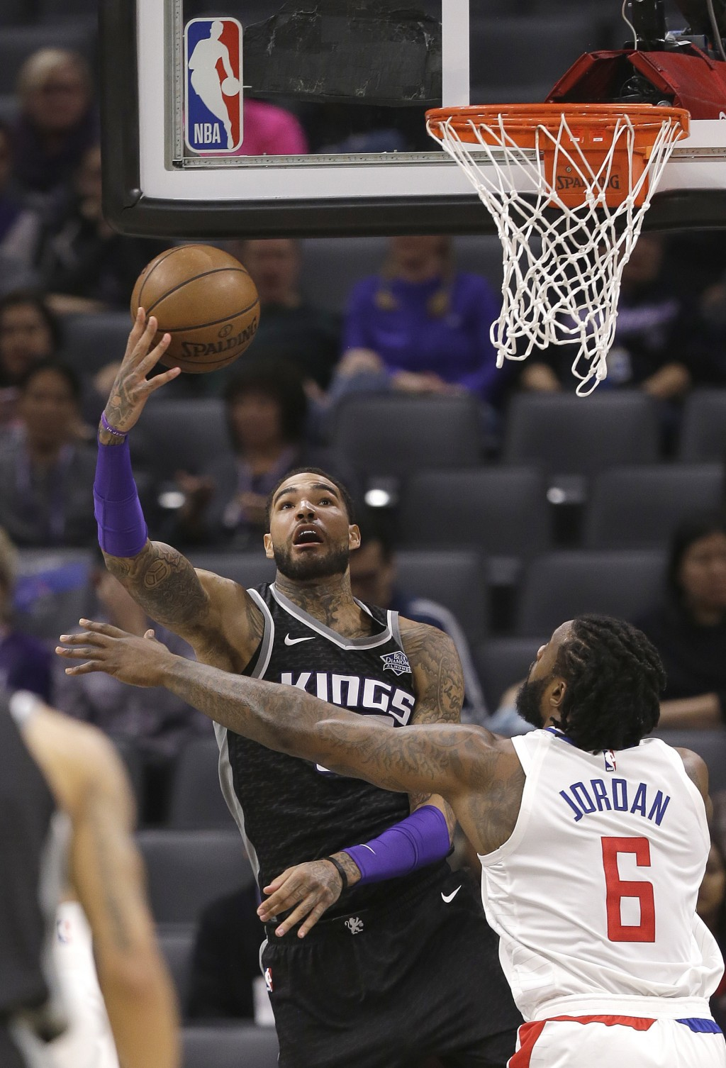 Sacramento Kings center Willie Cauley-Stein, left, goes to the basket against Los Angeles Clippers center DeAndre Jordan during the first quarter of a