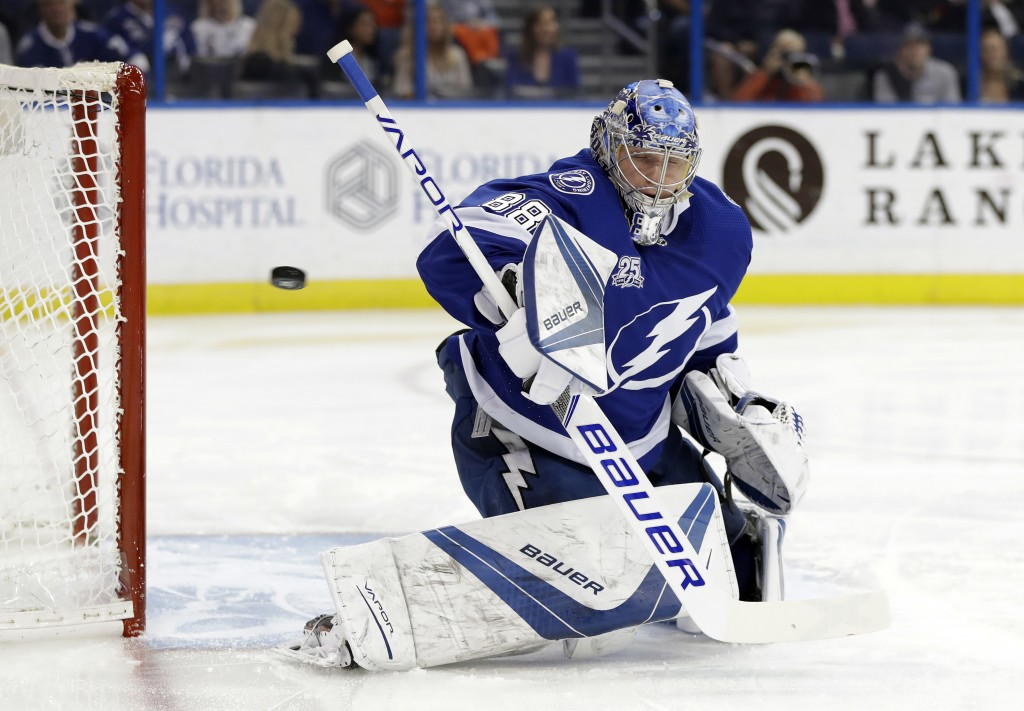Tampa Bay Lightning goaltender Andrei Vasilevskiy (88), of Russia, makes a blocker save on a shot by the Calgary Flames during the first period of an