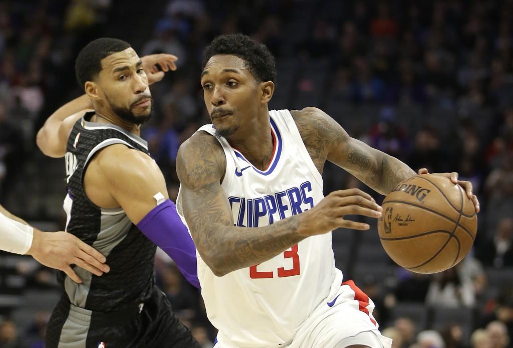 LA Clippers guard Lou Williams, right, drives against Sacramento Kings guard Garrett Temple during the first quarter of an NBA basketball game Thursda
