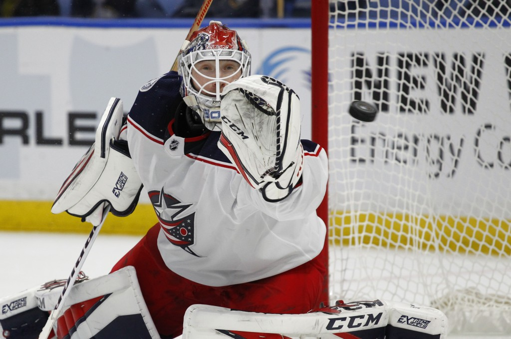 Columbus Blue Jackets goalie Sergei Bobrovsky reaches for the puck during the first period of the team's NHL hockey game against the Buffalo Sabres, T