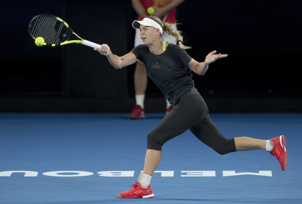 Denmark's Caroline Wozniacki makes a forehand return during a practice session on Rod Laver Arena ahead of the Australian Open tennis championships in