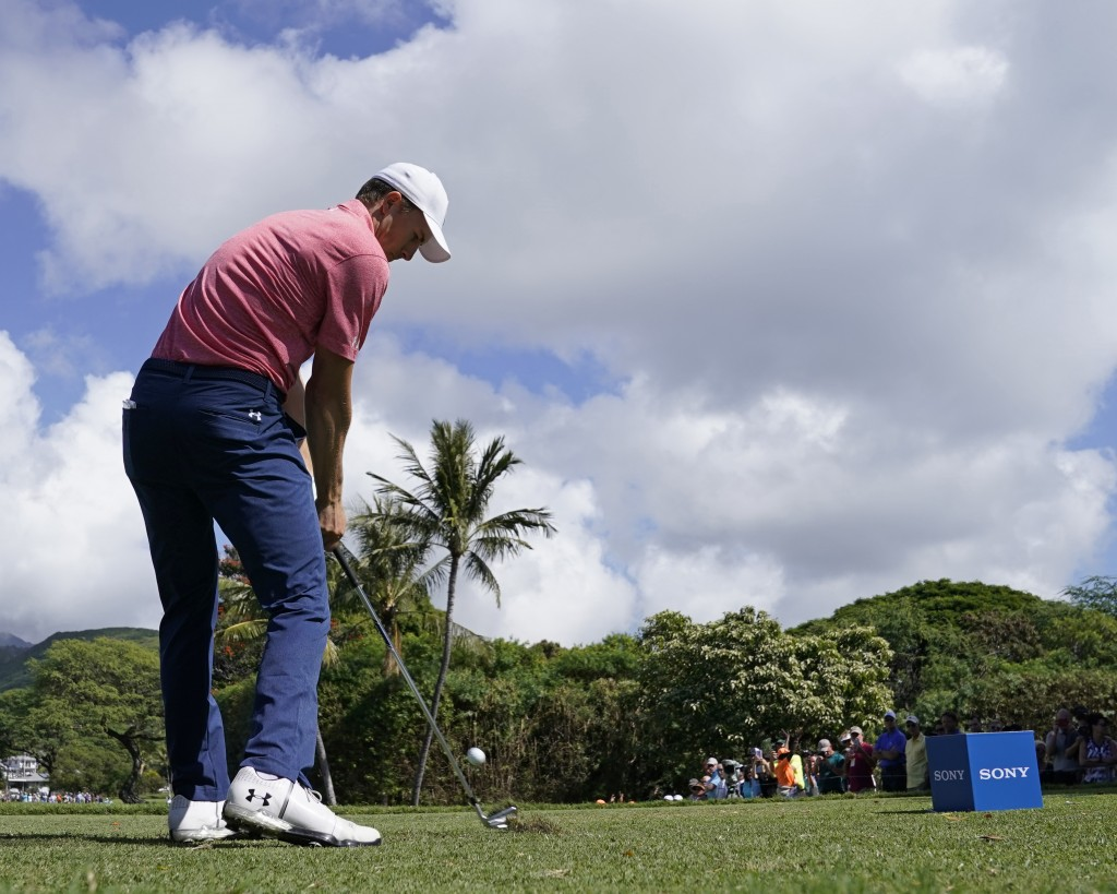 Jordan Spieth drives off the seventh tee during the first round of the Sony Open golf tournament, Thursday, Jan. 11, 2018, in Honolulu. (AP Photo/Marc