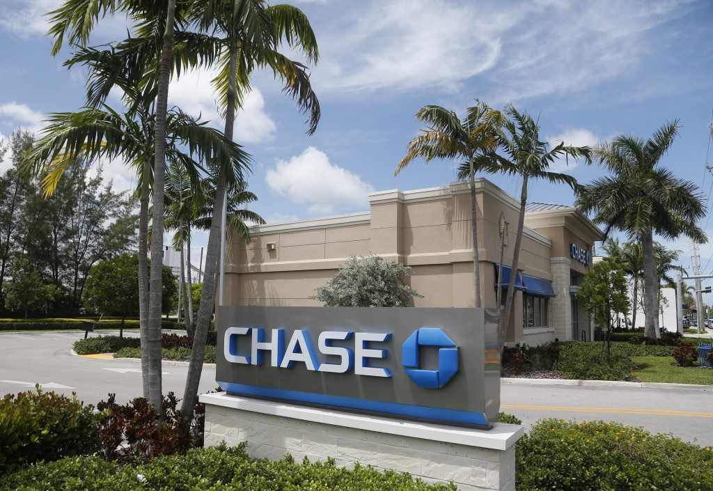 FILE - This Wednesday, Aug. 17, 2016, file photo, shows a Chase bank branch in North Miami Beach, Fla. JPMorgan Chase & Co. reports earnings, Friday,