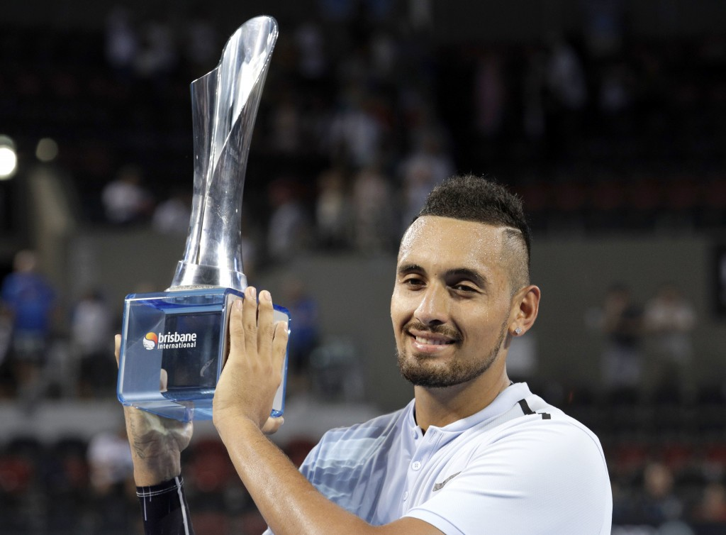 FILE - In this Sunday, Jan. 7, 2018 file photo Nick Kyrgios of Australia holds his trophy after winning his final match against Ryan Harrison of the U