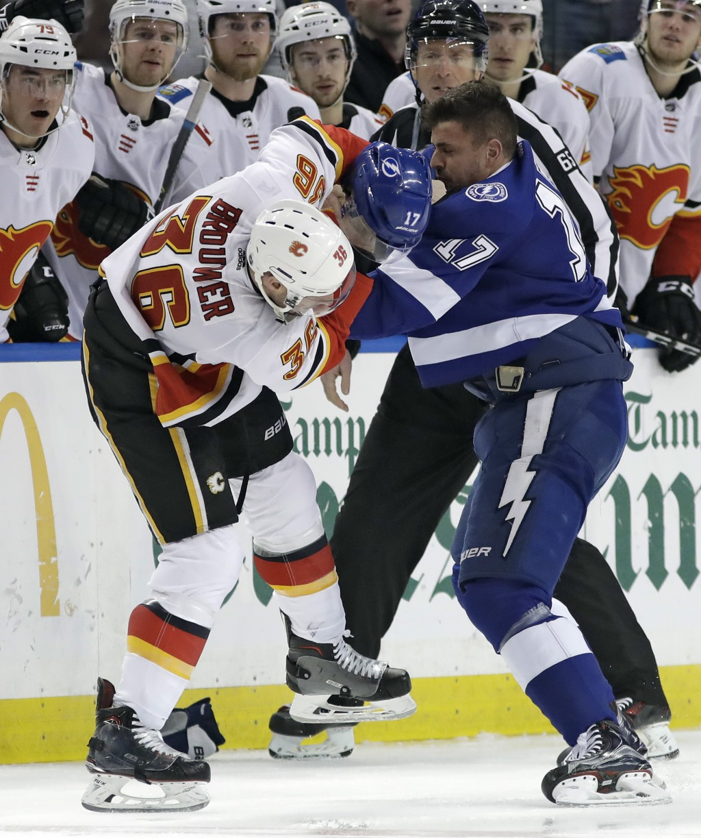 Calgary Flames right wing Troy Brouwer (36) and Tampa Bay Lightning left wing Alex Killorn (17) fight during the first period of an NHL hockey game Th