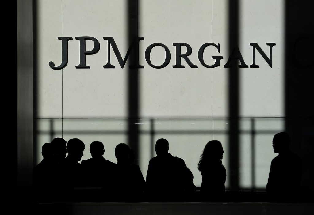 FILE - In this Monday, Oct. 21, 2013, file photo, the JPMorgan Chase & Co. logo is displayed at their headquarters in New York. JPMorgan Chase & Co. r