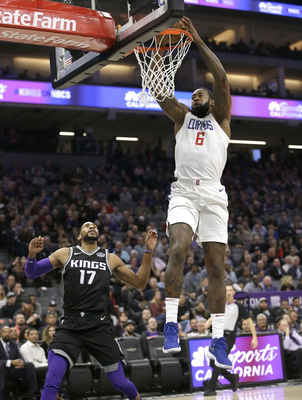 Los Angeles Clippers center DeAndre Jordan, right, stuffs over Sacramento Kings guard Garrett Temple game Thursday, Jan. 11, 2018, in Sacramento, Cali