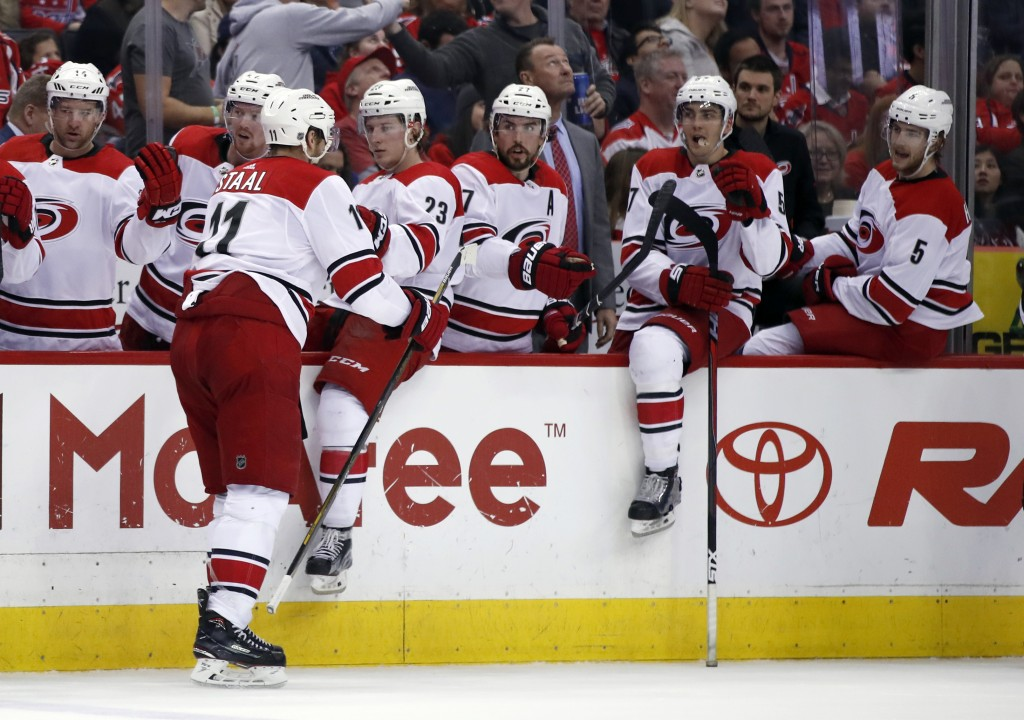 Carolina Hurricanes center Jordan Staal (11) celebrates his goal with teammates in the second period of an NHL hockey game against the Washington Capi