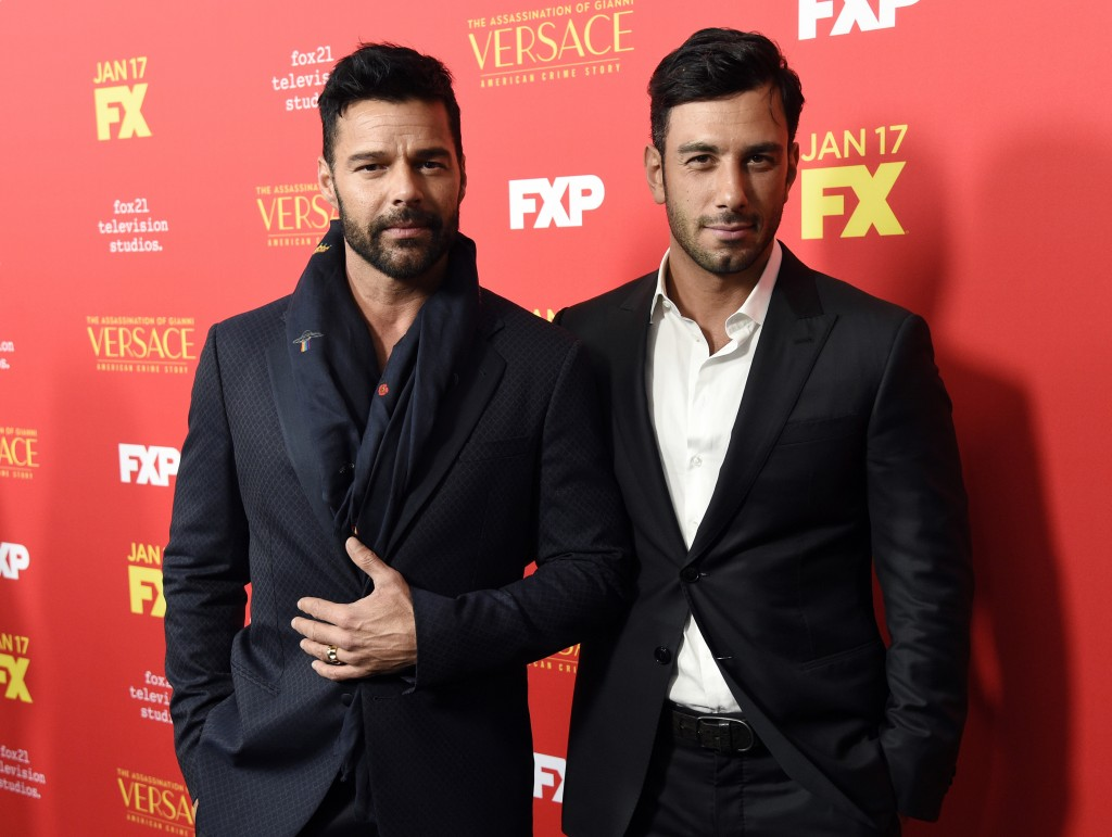 """FILE - In this Jan. 8, 2018, file photo, Ricky Martin, left, a cast member in """"The Assassination of Gianni Versace: American Crime Story,"""" poses with"""