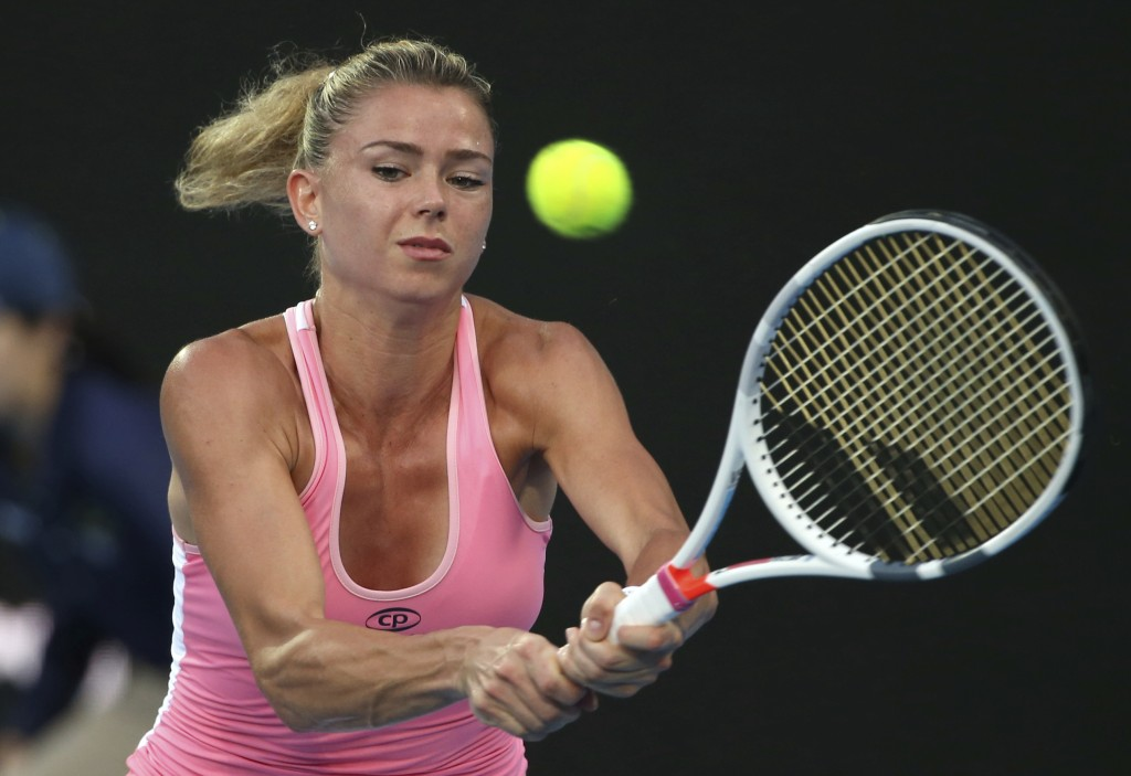 Camila Giorgi of Italy hits a backhand to Angelique Kerber of Germany during their women's semifinal singles match at the Sydney International tennis