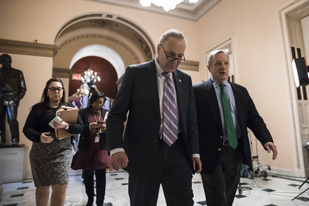 Senate Minority Leader Chuck Schumer, D-N.Y., left, walks with Sen. Dick Durbin, D-Ill., the minority whip, as lawmakers continue negotiating on a dea