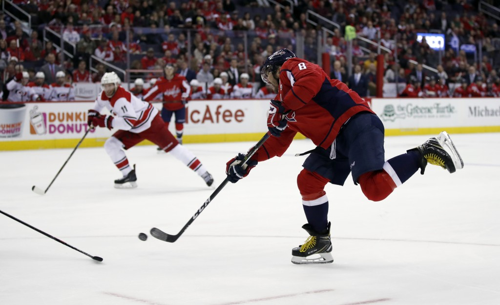 Washington Capitals left wing Alex Ovechkin (8), from Russia, shoots in the first period of an NHL hockey game against the Carolina Hurricanes, Thursd