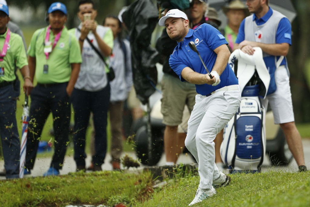 Tyrrell Hatton of Britain hits on the 8th hole during the four-ball matches of the 2018 EurAsia Cup golf tournament at Glenmarie Golf & Country Club i