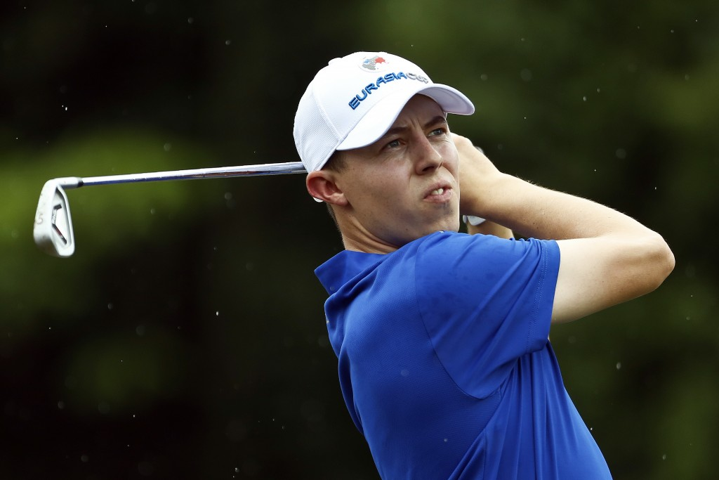Matthew Fitzpatrick of England tees off on the 17th hole during the four-ball matches of the 2018 EurAsia Cup golf tournament at Glenmarie Golf & Coun