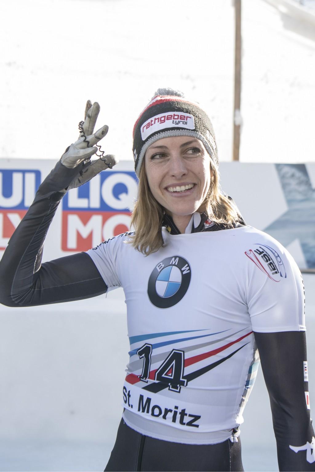 Janine Flock of Austria celebrates after winning the women's skeleton World Cup in St. Moritz, Switzerland, Friday, Jan. 12, 2018. (Urs Flueeler/Keyst
