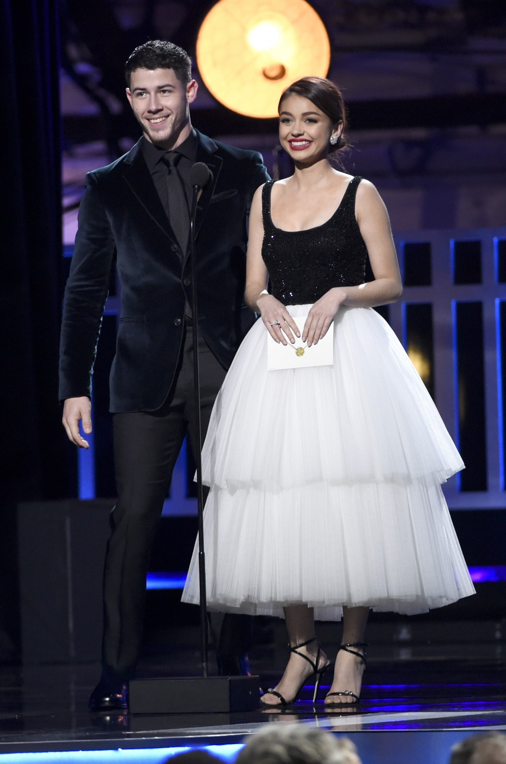 Nick Jonas, left, and Sarah Hyland present the award for best actor in a movie made for TV or limited series at the 23rd annual Critics' Choice Awards