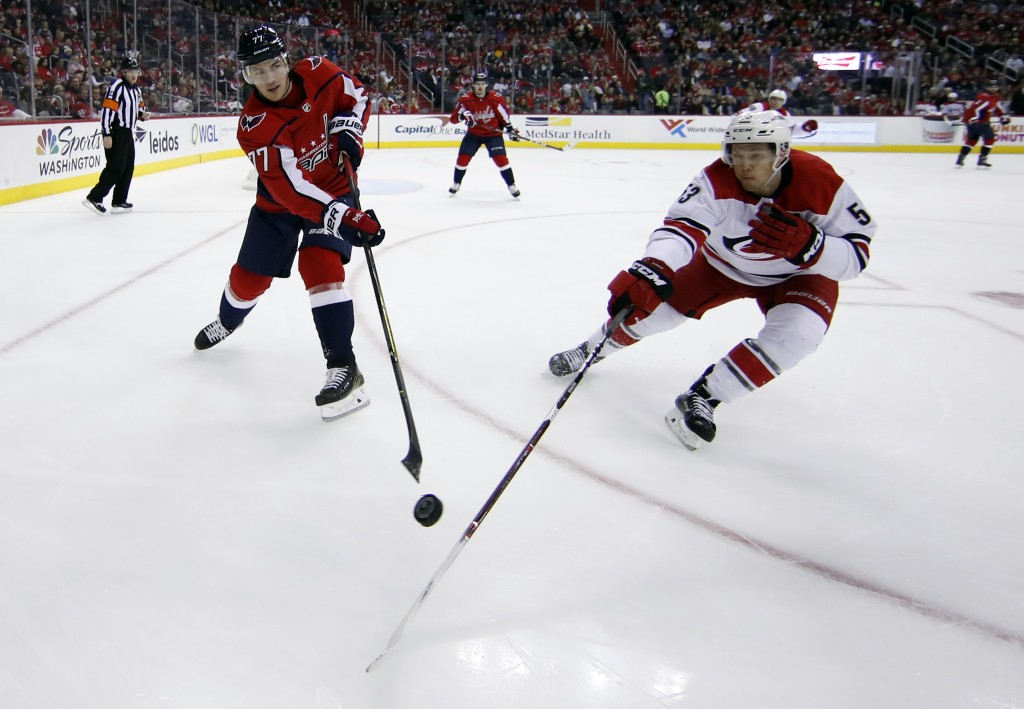 Washington Capitals right wing T.J. Oshie (77) passes the puck past Carolina Hurricanes left wing Jeff Skinner (53) in the second period of an NHL hoc