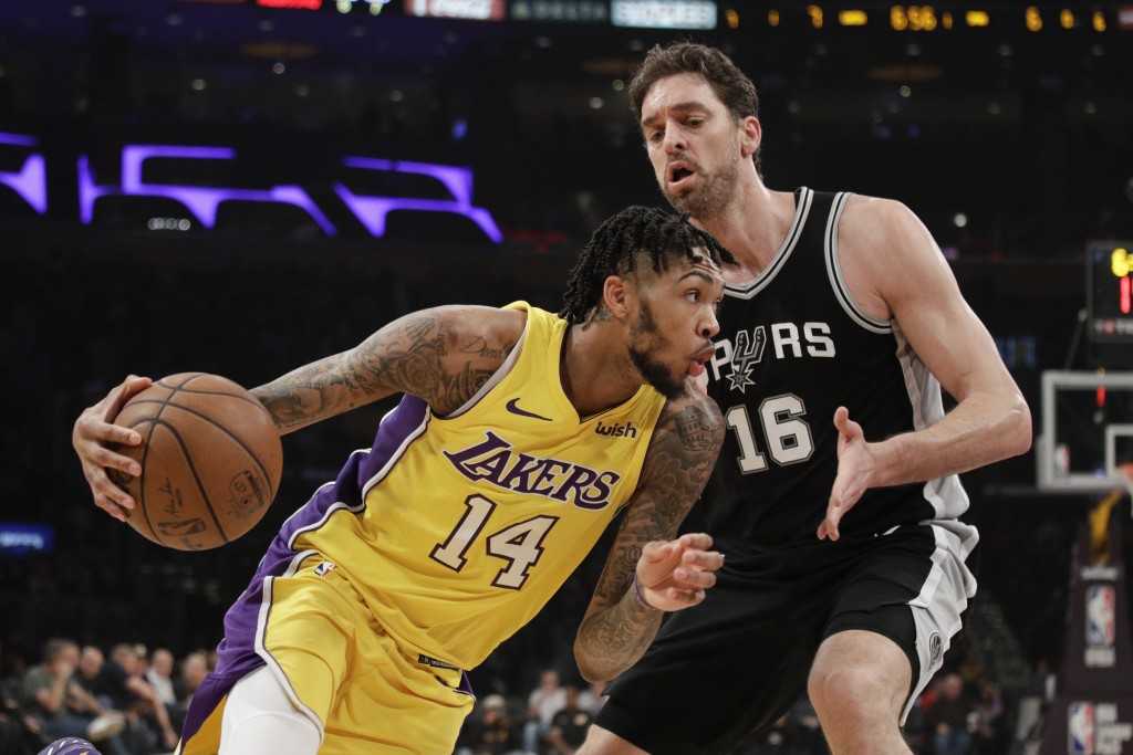 Los Angeles Lakers' Brandon Ingram, left, drives past San Antonio Spurs' Pau Gasol, of Spain, during the first half of an NBA basketball game Thursday