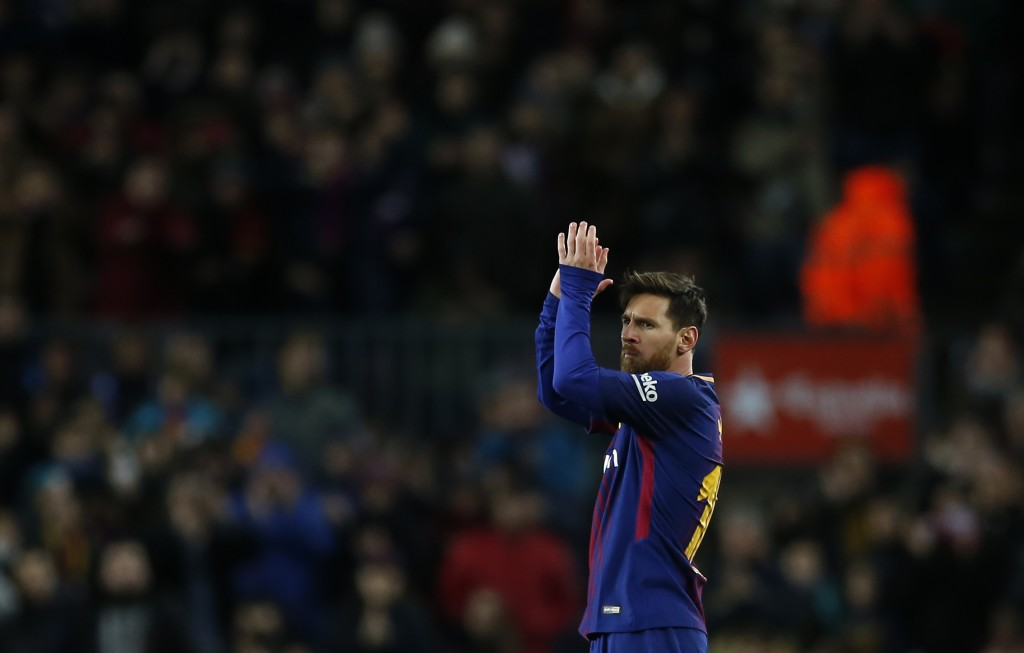 FC Barcelona's Lionel Messi applauds during the Spanish Copa del Rey round of 16 second leg soccer match between FC Barcelona and Celta de Vigo at the