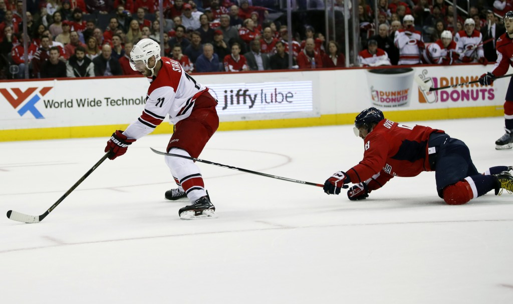 Carolina Hurricanes center Jordan Staal (11) prepares to score a shorthanded goal as Washington Capitals left wing Alex Ovechkin (8), from Russia, def