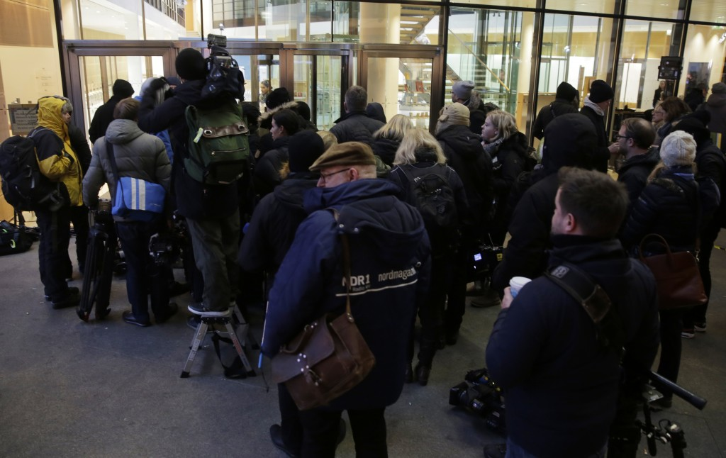 Journalists queue outside the Social Democrats party headquarters when waiting for statements after the exploratory talks between Merkel's Christian D