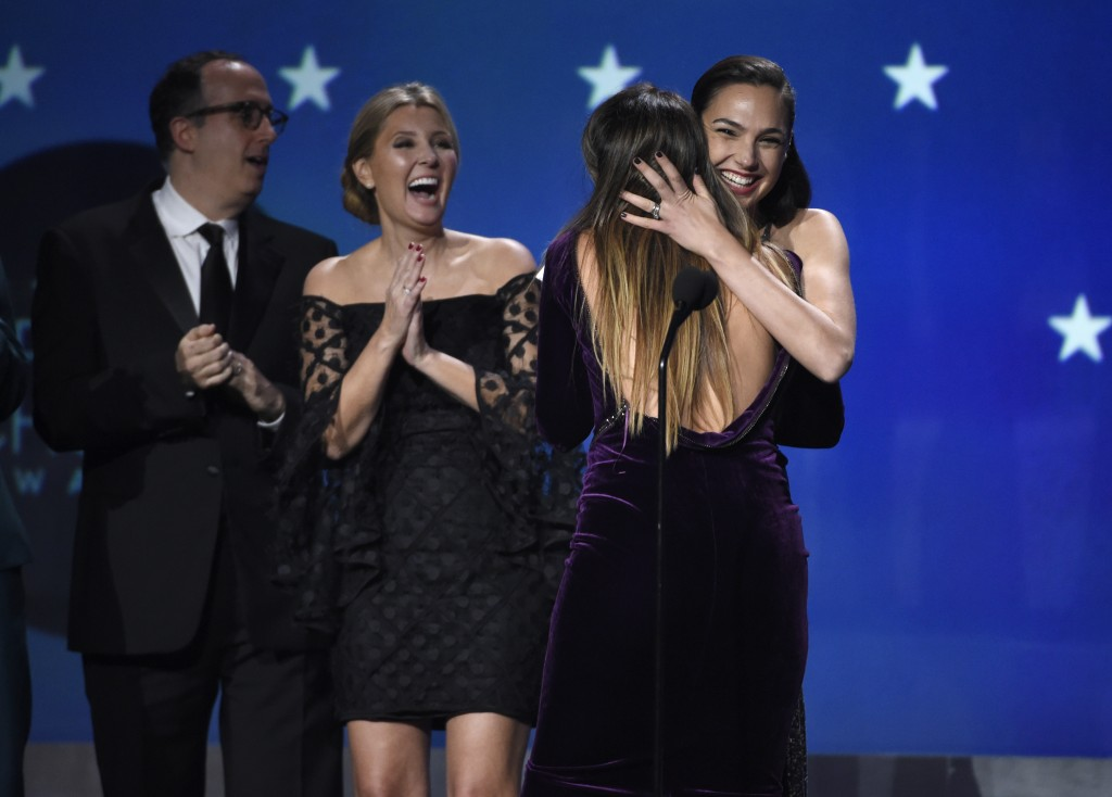 """Gal Gadot and Patty Jenkins embrace as """"Wonder Woman"""" wins the award for best action movie at the 23rd annual Critics' Choice Awards at the Barker Han"""