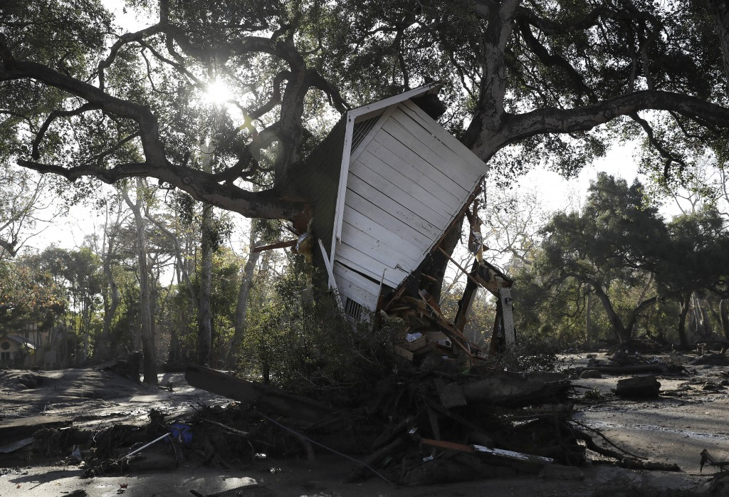 A structure damaged from storms is shown in Montecito, Calif., Thursday, Jan. 11, 2018.  Hundreds of rescue workers slogged through knee-deep ooze and