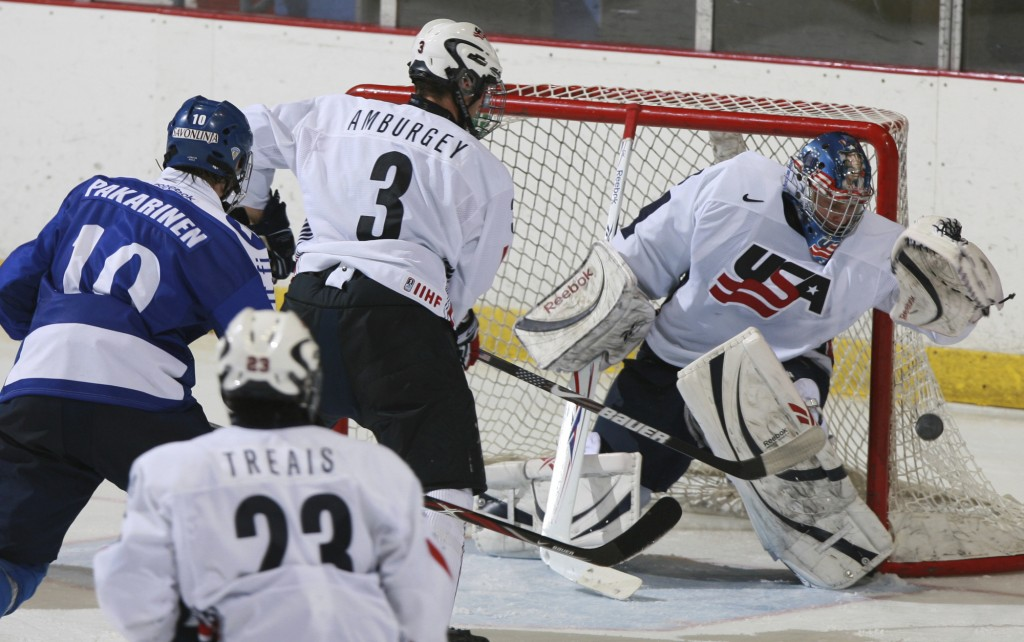 FILE - In this Nov. 8, 2008, file photo, United States' goalie Brandon Maxwell catches the puck as Tyler Amburgey (3) moves in to defend against Finla
