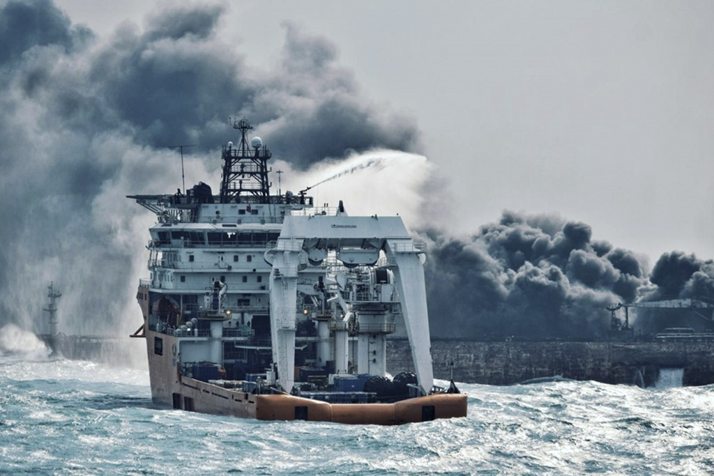 In this Jan. 10, 2018 photo provided by China's Ministry of Transport, a firefighting boat works to put on a blaze on the oil tanker Sanchi in the Eas