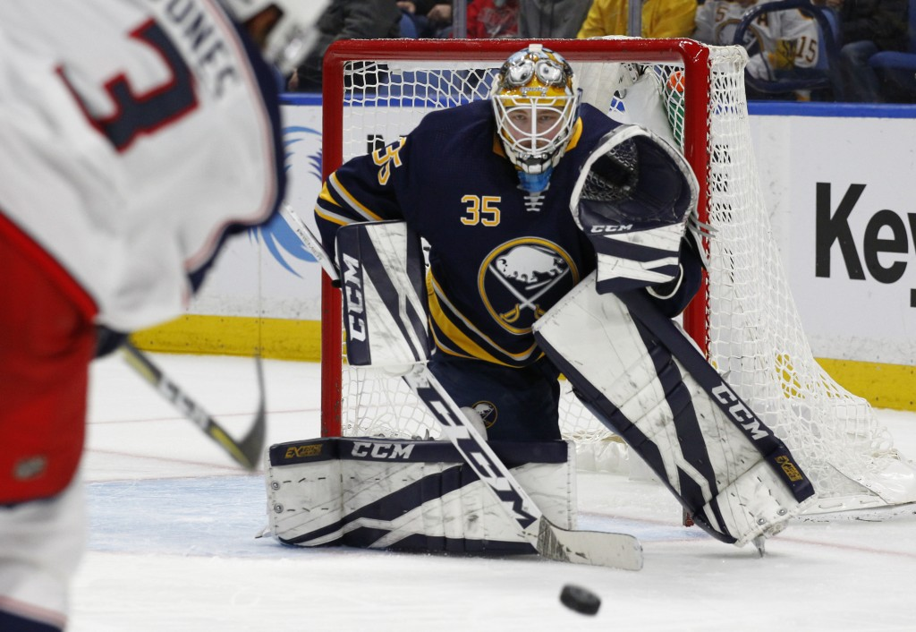Buffalo Sabres goalie Linus Ullmark (35) watches the puck after a shot by the Columbus Blue Jackets during the second period of an NHL hockey game Thu