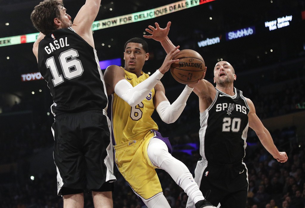 Los Angeles Lakers' Jordan Clarkson, center, is double-teamed by San Antonio Spurs' Pau Gasol, left, of Spain, and Manu Ginobili, of Argentina, during