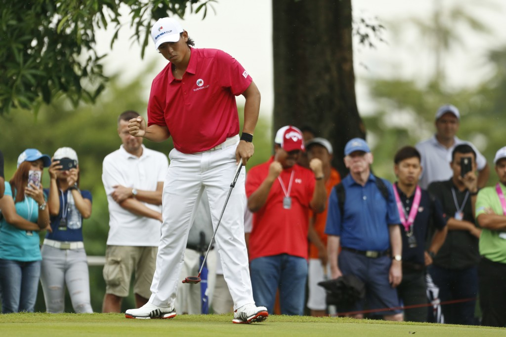 Gavin Green of Malaysia reacts after putt at 15th hole during the four-ball matches of the 2018 EurAsia Cup golf tournament at Glenmarie Golf & Countr