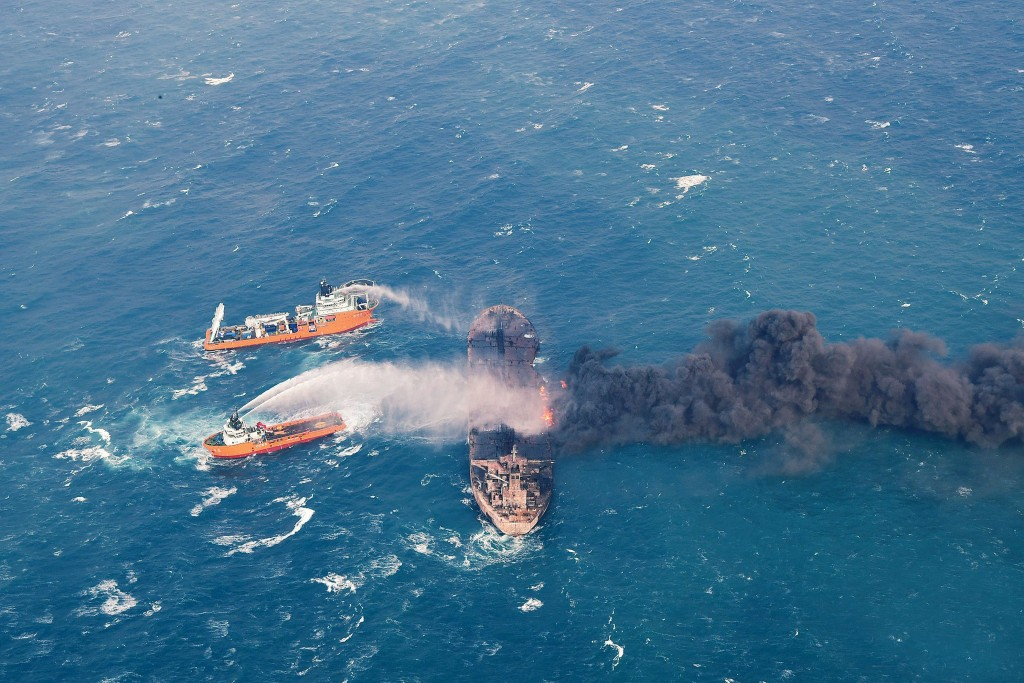 In this Wednesday, Jan. 10, 2018, photo provided by China's Ministry of Transport, firefighting boats work to put on a blaze on the oil tanker Sanchi