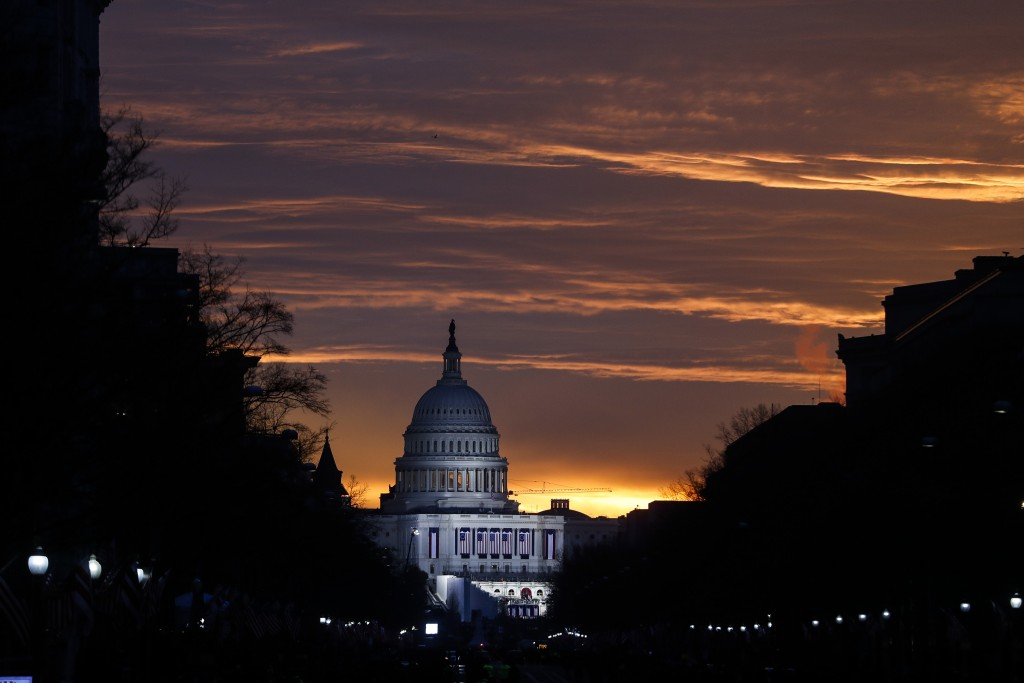 FILE - In this Friday, Jan. 20, 2017 file photo, the U.S. Capitol Building is illuminated during sunrise in Washington. The same Russian government-al