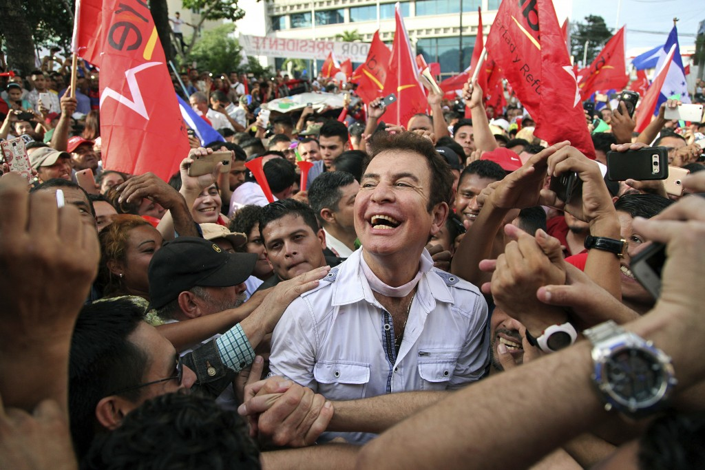 In this Jan. 6, 2018 photo, opposition leader Salvador Nasralla is surrounded by supporters as he arrives for a rally where he reaffirmed his claim on