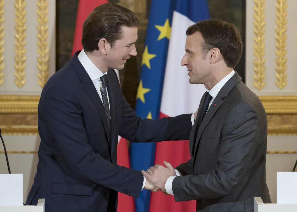 Austrian Chancellor Sebastian Kurz, left, meets French President Emmanuel Macron attend a media conference at the Elysee Palace in Paris, France, Frid