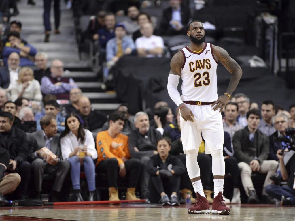 Cleveland Cavaliers forward LeBron James (23) reacts during a break in play during the second half of the team's NBA basketball game against the Toron