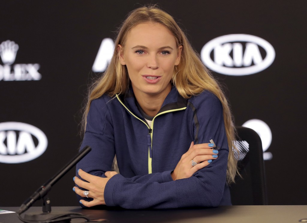 Denmark's Caroline Wozniacki answers questions during a press conference at the Australian Open tennis championships in Melbourne, Australia, Saturday