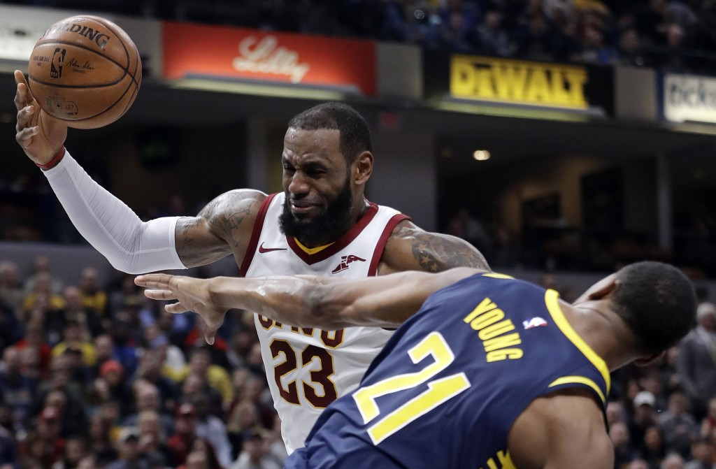 Cleveland Cavaliers' LeBron James (23) is fouled by Indiana Pacers' Thaddeus Young as he goes up to shoot during the first half of an NBA basketball g