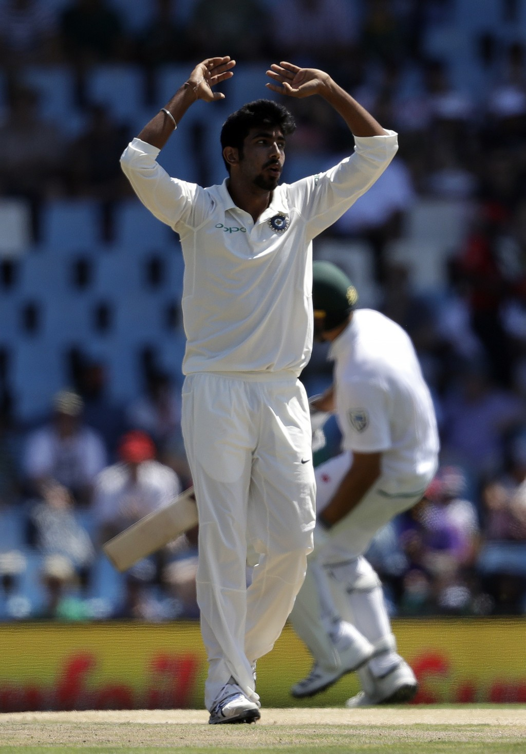 India's bowler Jasprit Bumrah, reacts after his delivery against South Africa's batsman Dean Elgar, during the first day of the second cricket test ma
