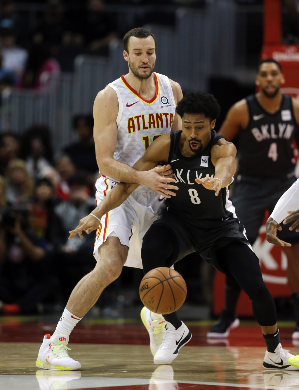 Brooklyn Nets guard Spencer Dinwiddie (8) and Atlanta Hawks center Miles Plumlee (18) battle for the ball in the first half of an NBA basketball game