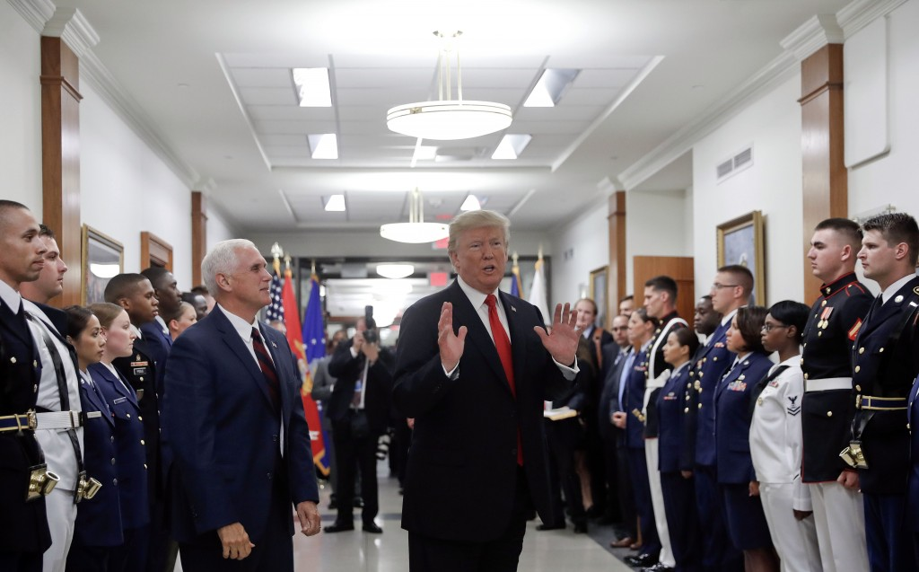 FILE - In this July 20, 2017, file photo, President Donald Trump stops to answer a reporter's question after greeting military personnel during a visi
