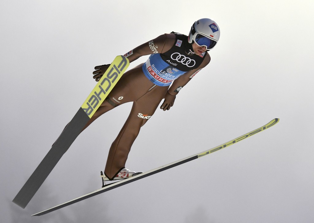 FILE - In this Jan. 5, 2018, file photo, Poland's KamilStoch makes his trial jump at the ski jump in Bischofshofen, Austria, the fourth stage of the