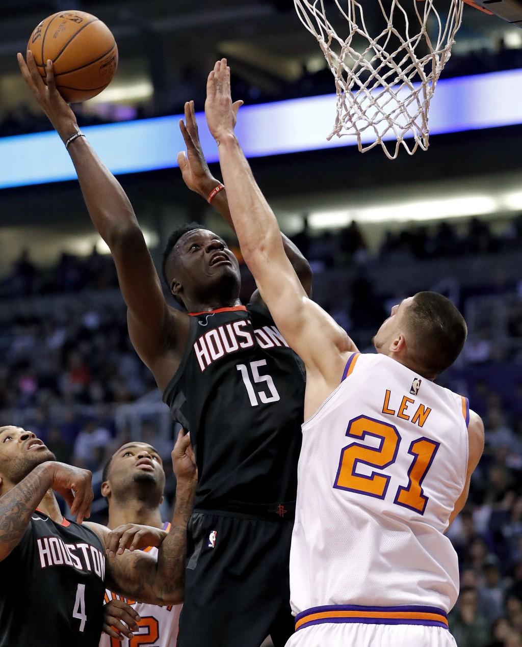 Houston Rockets center Clint Capela (15) shoots over Phoenix Suns center Alex Len (21) during the first half of an NBA basketball game Friday, Jan. 12